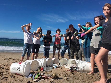 Heirs participating in a beach cleanup. Copyright Heirs to our Oceans.